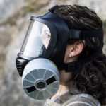 Woman with the CM-6M CBRN gas mask