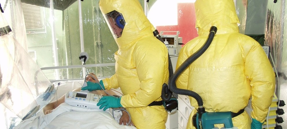 2 men working on Ebola Prevention