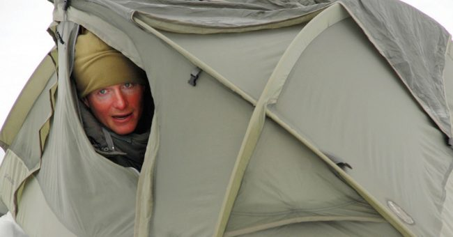 Man in a Tent Showing Basic Survival Skills