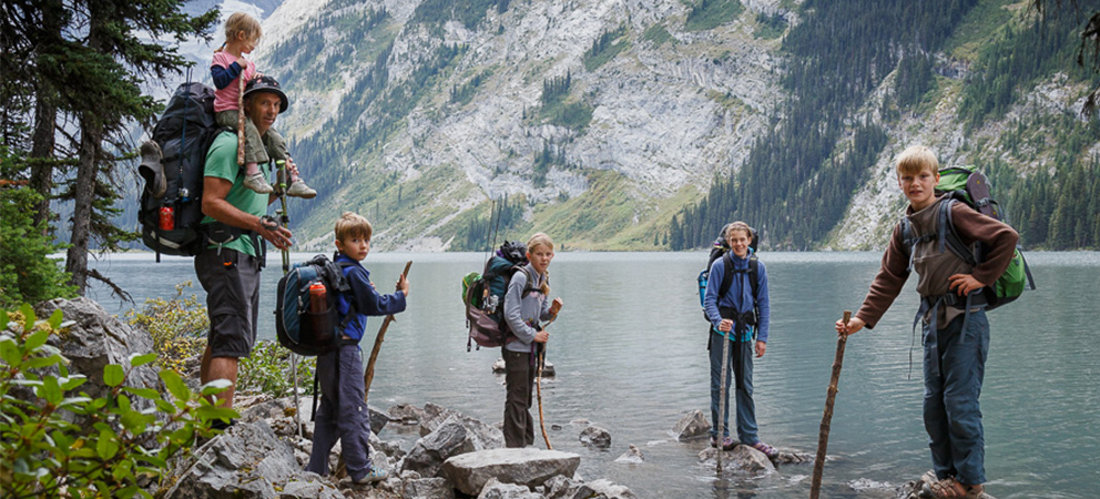 Family with survival kits in the wilderness