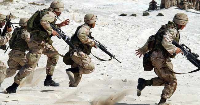 Soldiers with a survival mindset rushing a white sand beach