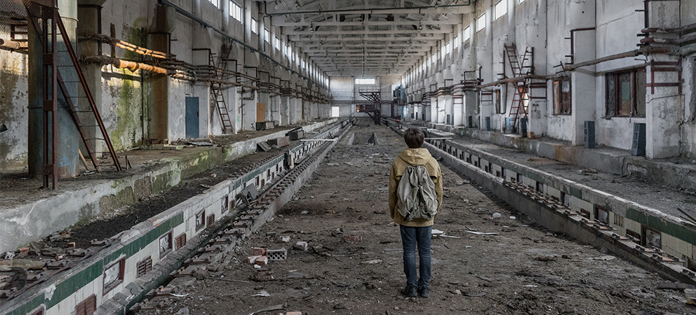 Grey Man in an abandoned dirty building