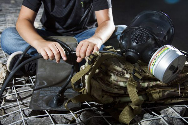 Military gas mask hydration bladder connection